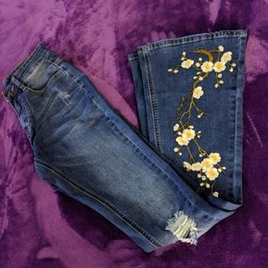 Ripped bell bottom jeans  Daisy's brand new jeans.